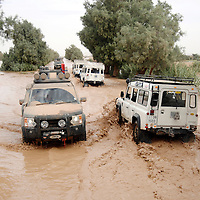 Rissani, Morocco 28 October 2006<br /> A 4 x 4 British tourists caravane cross a flooded river.<br /> Photo: Ezequiel Scagnetti
