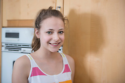 Portrait of girl in kitchen, smiling
