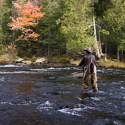 A fly-fisherman on the Connecticut River in Pittsburg, New Hampshire.  Below First Connecticut Lake Dam.