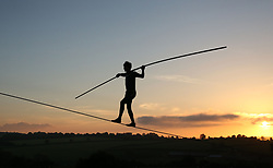 May 27, 2017 - Bruton, Somerset, UK - Bruton, UK. Chis Bullzini walks a tightrope at sunset as revellers attend the Shindig Weekender festival in Bruton, Somerset on a warm and sunny weekend. (Credit Image: © Jason Bryant/London News Pictures via ZUMA Wire)