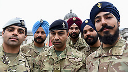 © Licensed to London News Pictures. 28/04/2018. LONDON, UK.  Members of the British Armed Forces Sikh Association pose during the festival of Vaisakhi in Trafalgar Square, hosted by the Mayor of London.  For Sikhs and Punjabis, the festival celebrates the spring harvest and commemorates the founding of the Khalsa community over 300 years ago.  Photo credit: Stephen Chung/LNP