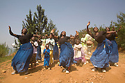May0016089 . Daily Telegraph..Features.Dancers on Nkombo Island welcome Rwanda Aid's David Chaplin and the Daily Telegraph team ashore. The islands inhabitants have received help from  Rwanda Aid, a British charity and recipient of funds from the Daily Telegraph's 2005 Christmas appeal...The pop group Keane have helped to fund 5 homes on the island with built in composting toilets and water filtration.  ..Rwanda was the scene of a brutal civil and genocide which ended in 1994 leaving behind 800,000 dead, hundreds of thousands of refugees, many orphans suffering with mental trauma . Still recovering from the civil war the small,landlocked central African state is one of the poorest countries in the world with three quarters of it's 10 million population living below the poverty line and is a huge recipient of foreign aid....Rwanda 28 August 2009