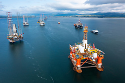 North Sea Oil and gas industry platforms and drilling rigs mothballed and moored in Nigg Bay in Cromarty Firth, Ross and Cromarty, Scotland, UK