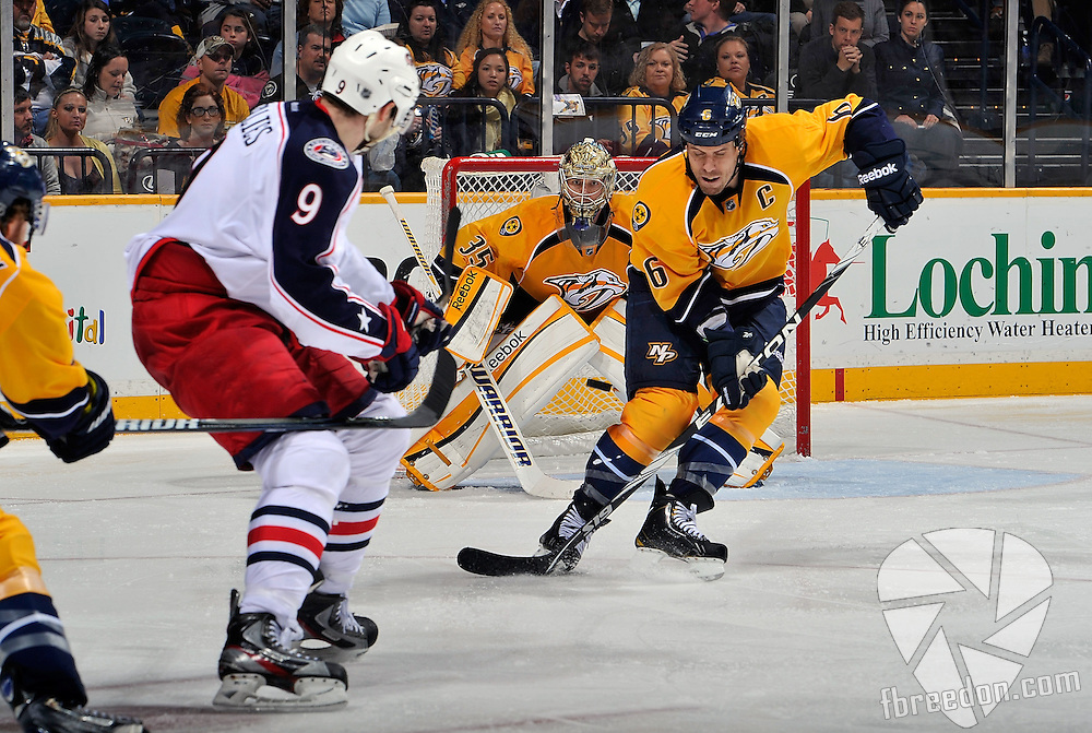 NASHVILLE, TN - MARCH 23:  Colton Gillies #9 of the Columbus Blue Jackets takes a backhand past defenceman Shea Weber #6 and on goalie Pekka Rinne #35 of the Nashville Predators at the Bridgestone Arena on March 23, 2013 in Nashville, Tennessee.  (Photo by Frederick Breedon/Getty Images)