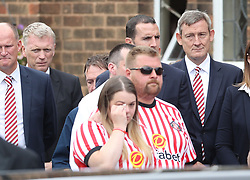 David Moyes (second left) and Ellis Short (right) outside St Joseph's Church in Blackhall, County Durham. where the funeral of Bradley Lowery, the six-year-old football mascot whose cancer battle captured hearts around the world, took place.