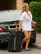 EXCLUSIVE<br />Model and TV star of Gypsy Weddings Danielle Mason and sister of Eastenders star Jessie Wallace returns home after what looks like a night away!! wearing just a shirt and Thong as she took her case from her car , Danielle is said to have set her sights on BB star Bear!<br />©Exclusivepix Media