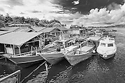 Fishing boats in the Mentawai Islands, Indonesia. Black and white photograph.