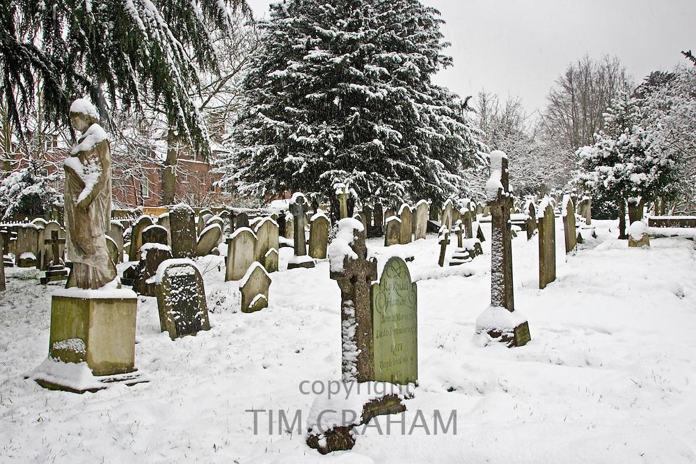 Snow covered gravestones in Hampstead Parish churchyard, London, United Kingdom