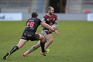 Zak Hardaker (3) of Wigan Warriors attempts to outrun Jack Wells (26) of Salford Red Devils