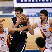 Galatasaray's Ender ARSLAN (L), Furkan ALDEMIR (R) and Anadolu Efes's Stanko BARAC (C) during their BEKO Basketball League derby match Galatasaray between Anadolu Efes at the Abdi Ipekci Arena in Istanbul at Turkey on Sunday, November 13 2011. Photo by TURKPIX