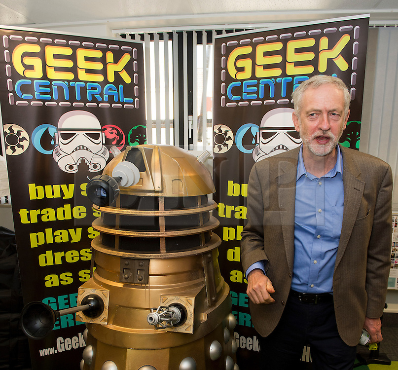 """**FILE PICTURE - Monday December 21 marks 100 days since Jeremy Corbyn became leader of the Labour Party** © Licensed to London News Pictures. 26/09/2015. Brighton, UK. Leader of the Labour Party JEREMY CORBYN poses next to a darlek underneath the words """"GEEK CENTRAL"""" during a visit to Entrepreneurial Spark in Brighton, a group that promotes entrepreneuring. The visit takes place on the eve of the Labour Party conference, which is being held in Brighton Photo credit: Ben Cawthra/LNP"""
