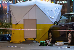 © Licensed to London News Pictures. 23/04/2021. London, UK. A forensic tent and medical equipment on Barking Road in Canning Town following the fatal stabbing of a 14-year-old boy. Police were called at 15:56 BST on Friday, 23 April to reports of an assault in Barking Road, E16. Metropolitan Police officers attended with medics from the London Ambulance Service and the London Air Ambulance. They found a 14-year-old male who had been stabbed. He was pronounced dead shortly after 16:30 BST. Photo credit: Peter Manning/LNP