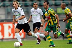 22-07-2009 VOETBAL: ADO DEN HAAG - VALENCIA CF: DEN HAAG<br /> Valencia wint met 4-1 van Den Haag / Ricky van den Bergh en Raul Albiol Tortajada<br /> ©2009-WWW.FOTOHOOGENDOORN.NL