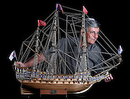 Jose Joy Colon spent five months building this wooden model ship, the HMS Sovereign of the Seas, in his garage at his home in Coral Gables.  Jose built it for his son, Jose Joy. The British Royal Navy ship designed in the 1630's by Phineas Pett was the first ship to have three full gun decks, carrying 102 guns on the orders of King Charles I. No expense was spared in her construction. The ship was later renamed Sovereign and Royal Sovereign. Colon is seen here with the model on Friday, March 13, 2015.