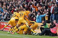 Newport County players celebrate with the fans after Newport county's Mark O'Brien (bottom of pile) scores the match winning goal securing their survival in the football league. EFL Skybet football league two match, Newport county v Notts County at Rodney Parade in Newport, South Wales on Saturday 6th May 2017.<br /> pic by David Richards, Andrew Orchard sports photography.