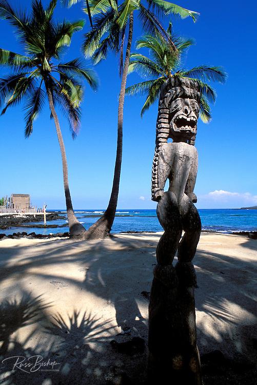 Wooden tiki and coconut palms at Pu'uhonua o Honaunau National Historic Park (City of Refuge), Kona Coast, Hawaii