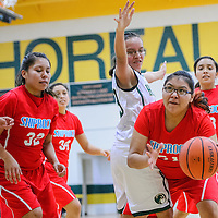 012015       Cable Hoover<br /> <br /> Shiprock Chieftain Keishonna Begay (51) pushes past Thoreau Hawk Avery Sanders (23) Tuesday at Thoreau High School.