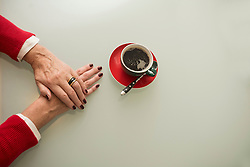 Close-up of senior woman's hand and black coffee on table, Munich, Bavaria, Germany