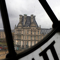 Europe, France, Paris. View of Louvre from Musee D'orsay Clock.
