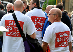 """© licensed to London News Pictures. LONDON, UK.  07/09/11. Men wear t-shirts that says """"Save British Jobs'.  A large group of Unite members working at Bombardier, along with business leaders and Derby councillors call on the government to """"save British train manufacturing"""" outside parliament today. The delegation's visit, which coincides with the Transport Committee hearing, includes Unite general secretary Len McCluskey, the leader of Derby City Council and the Mayor of Derby.. Mandatory Credit Stephen Simpson/LNP"""