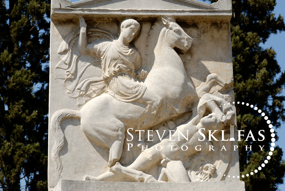 Copy of the Memorial stele of Dexileos, a young man killed in battle at Corinth in 394 BC. Kerameikos. Athens. Greece. The 20 year old son of Lysanias of Thorikos, Dexileos is shown on the relief as a cavalryman slaying an adversary. The stele or relief sculpture is located on the Street of the Tombs, which is the excavated part of the ancient main road to Piraeus. Serving as a burial ground as long ago as the 12th century BC, Kerameikos located in the ancient neighbourhood of potters contains part of the ancient city walls and the Dipylon, the main gate of Ancient Athens at a junction of the Sacred Way and Panathenaic Way. It served as a burial ground for the richest and most distinguished citizens of the city.