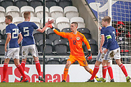 Cieran Slicker (Mancester City) celebrates with his team mates following his penalty save during the U17 European Championships match between Scotland and Russia at Simple Digital Arena, Paisley, Scotland on 23 March 2019.