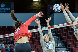 BLOOMINGTON, IL - October 23: Kaitlyn Prondzinski  powers a stike towards Kacie Rewerts and Haley Bush during a college Women's volleyball match between the ISU Redbirds and the Drake Buldogs on October 23 2021 at Illinois State University in Normal, IL. (Photo by Alan Look)