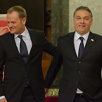 Donald Tusk (L) prime minister of Poland and his counterpart Viktor Orban (R) Prime Minister of Hungary leave a press conference in Budapest, Hungary on January 29, 2014. ATTILA VOLGYI