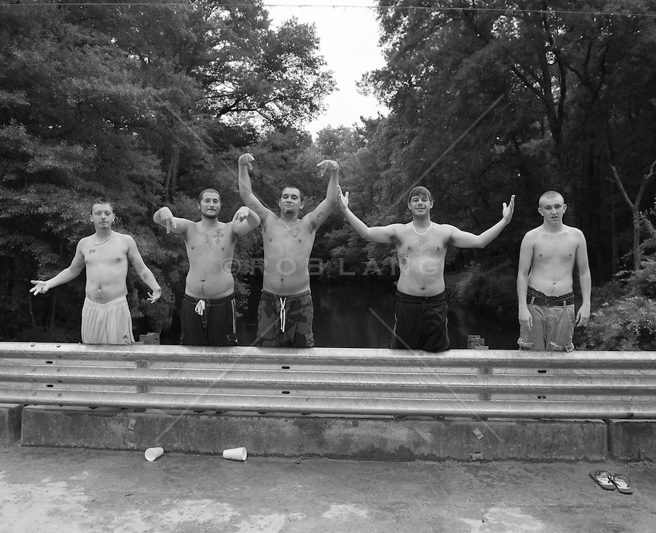 Shirtless young men on a bridge in South Carolina