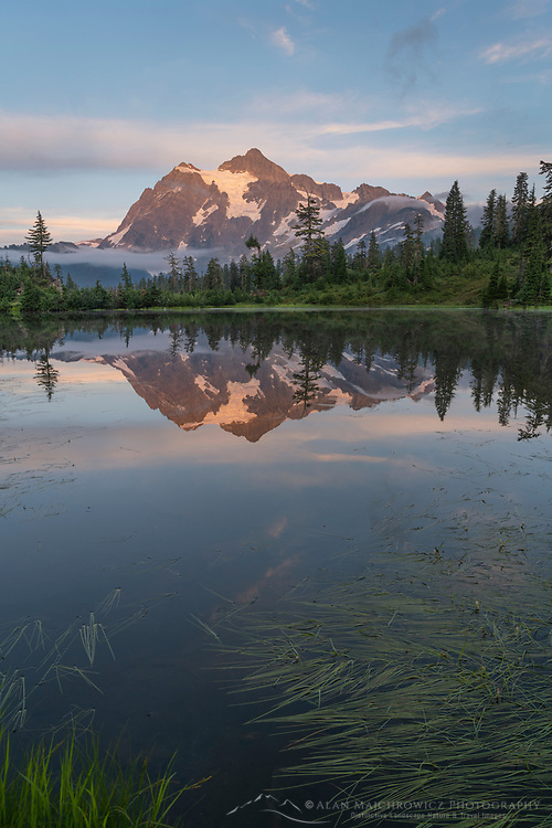 Mount Shuksan reflected in Picture Lake. Heather Meadows Recreation Area, Mount Baker Snoqulane National Forest. North Cascades Washington