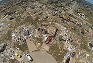 All of the homes on a cul-de-sac lie in ruins in the wake of the May 20, 2013 tornado in Oklahoma City, Oklahoma May 22, 2013.  Rescue workers with sniffer dogs picked through the ruins on Wednesday to ensure no survivors remained buried after a deadly tornado left thousands homeless and trying to salvage what was left of their belongings. Curvature of horizon in the photo is due to an ultra-wide angle lens.  REUTERS/Rick Wilking (UNITED STATES)