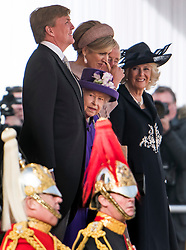 © Licensed to London News Pictures. 23/10/2018. London, UK. King Willem-Alexander, Queen Elizabeth II, Queen Maxima and Camilla, Duchess of Cornwall, share a joke during a ceremony on Horse Guards Parade in London for the arrival of King Willem-Alexander and Queen Maxima of the Netherlands as part of a state visit to the UK. Photo credit: Ben Cawthra/LNP