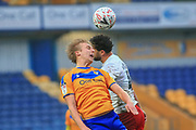 George Lapslie of Mansfield Town (32) heads the ball during the The FA Cup match between Mansfield Town and Dagenham and Redbridge at the One Call Stadium, Mansfield, England on 29 November 2020.
