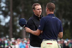 April 8, 2018 - Augusta, GA, USA - Jordan Spieth, left, and Justin Thomas on 18 after Spieth bogied to fall to 13 under for the round during the final round of the Masters at Augusta National Golf Club on Sunday, April 8, 2018, in Augusta, Ga. (Credit Image: © Curtis Compton/TNS via ZUMA Wire)