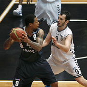 Besiktas's Bekir YARANGUME (R) and Efes Pilsen's Lawrence ROBERTS (L) during their Turkish Basketball league derby match Besiktas between Efes Pilsen at the BJK Akatlar Arena in Istanbul Turkey on Saturday 30 April 2011. Photo by TURKPIX