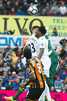 Football - 2016 / 2017 Premier League - Swansea City vs. Hull City<br /> <br /> Eldin Jakupovic of Hull City challenged by Leroy Fer of Swansea City punches the ball clear -- at the Liberty Stadium.<br /> <br /> COLORSPORT/WINSTON BYNORTH