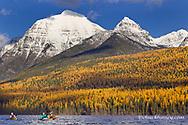 Sea kayaking on Bowman Lake in autumn in Glacier National Park,. Montana, USA MR
