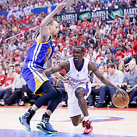 21 April 2014: Los Angeles Clippers guard Darren Collison (2) drives past Golden State Warriors guard Stephen Curry (30) during the Los Angeles Clippers 138-98 victory over the Golden State Warriors, during Game Two of the Western Conference Quarterfinals of the NBA Playoffs, at the Staples Center, Los Angeles, California, USA.