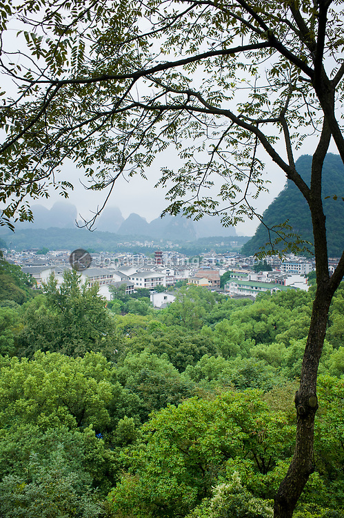 High angle view of Yangshuo, China framed by Karst formations.