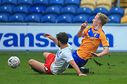 Harry Charsley of Mansfield Town (7) is challenged by Dean Rance (4) of Dagenham & Redbridge during the The FA Cup match between Mansfield Town and Dagenham and Redbridge at the One Call Stadium, Mansfield, England on 29 November 2020.