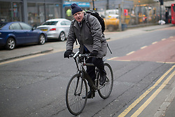 © licensed to London News Pictures. London, UK 25/03/2013.The Mayor of London Boris Johnson cycling on Shacklewell Lane before launching the Mayor's Police and Crime Plan in Dalston, London. Photo credit: Tolga Akmen/LNP