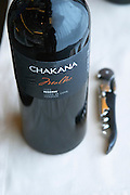 Bottle of Chakana Malbec 2003 Reserve Lujan de Cuyo Mendoza and a cork screw. The Restaurant Red at the Hotel Madero Sofitel in Puerto Madero, Buenos Aires Argentina, South America