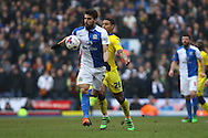 Jordi Gomez of Blackburn Rovers gets in front of Liam Bridcutt of Leeds United. Skybet football league Championship match, Blackburn Rovers v Leeds United at Ewood Park in Blackburn, Lancs on Saturday 12th March 2016.<br /> pic by Chris Stading, Andrew Orchard sports photography.