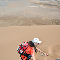 26 March 2007: #347 Laurence Fricotteaux of France takes the lead in the women race as she reaches summit of jebel El Otfal, 947 meters and an average 25% slope, during the second stage (21.7 miles) of the 22nd Marathon des Sables between Khermou and jebel El Otfal. The Marathon des Sables is a 6 days and 151 miles endurance race with food self sufficiency across the Sahara Desert in Morocco. Each participant must carry his, or her, own backpack containing food, sleeping gear and other material.