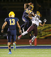 McKinney's Ben Gordon breaks up a pass intended for Brendon Palmer during a game between McKinney High and Plano Senior High on Friday, Sept. 30, 2016 at Ron Poe Stadium in McKinney. It was McKinney High's homecoming game. McKinney won 31-28. (Photo by Kevin Bartram/buzzphotos.com