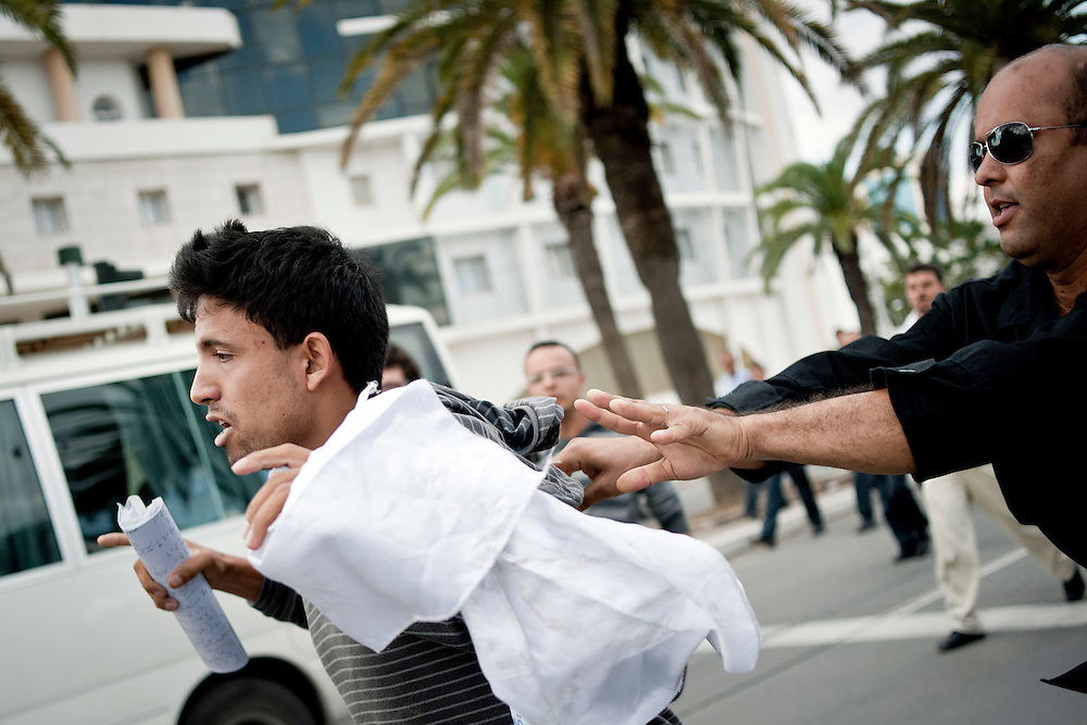 USE ARROWS ← → on your keyboard to navigate this slide-show<br /> <br /> Tunis, Tunisia, 16 October 2011<br /> An islamist demonstrator is arrested by a policeman while Tunisians where demonstrating for peace, freedom of speech and a secular state.<br /> An election for a Constituent Assembly will be held in Tunisia on 23 October 2011, following the Tunisian Revolution.<br /> Photo: Ezequiel Scagnetti