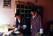 Stamping the post at Paro post office, Bhutan