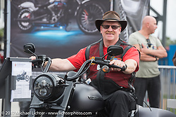 Trying out the new 2017 Road King Special at the Harley-Davidson display at the Daytona Speedway during Daytona Bike Week. Daytona Beach, FL. USA. Monday March 13, 2017. Photography ©2017 Michael Lichter.