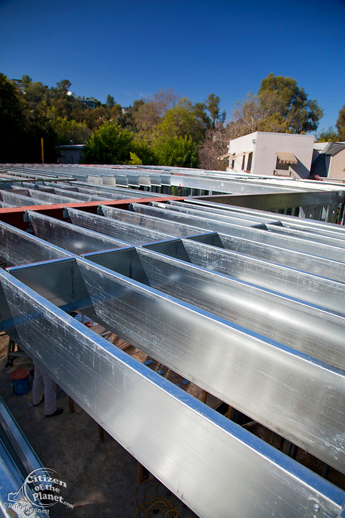 """On 3/14/2013 the steel framing continues to be assembled over the foundation on the Begley's new home. Steel, while not a common material for residential framing, is 94% recyclable, has been milled locally for this project, and is a more sustainable choice than wood, which is typically used for residential building construction. Ed Begley Jr. (noted actor and environmentalist) and his wife Rachelle Carson-Begley are building their new home under LEED Platinum Certified standards in an attempt to become North America's greenest, most sustainable home. It is also being filmed for their web series """"On Begley Street."""" Studio City, California, USA"""