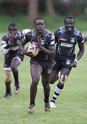 Bright Anditi (C)  and Collins Injera (R) of Mwamba RFU leads his team against Mean Machine during their Kenya Cup Tournament at Railway Club In Nairobi, on 3rd December 2016. Mwamba won 51-8. Photo/Fredrick Onyango/www.pic-centre.com (KEN)